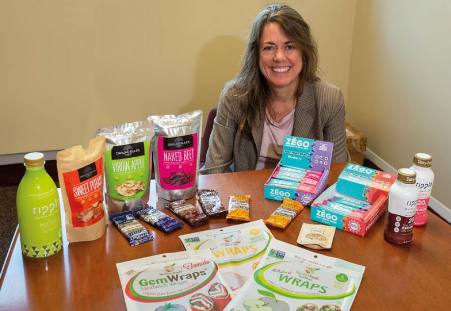 Tara McHugh, food technologist and director of the ARS Western Regional Research Center, with some of the many products researched and developed by her team in the Healthy Processed Foods Research Unit.